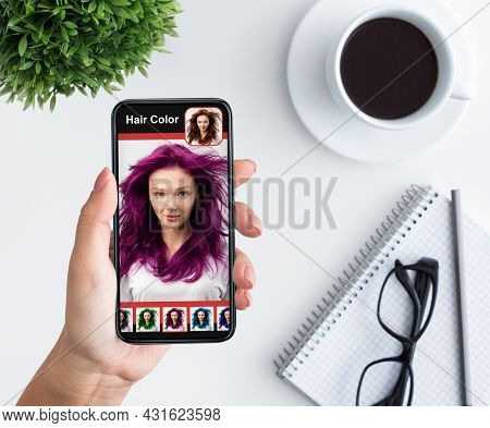 Woman Trying New Hairstyle Via Hair Simulation Mobile App