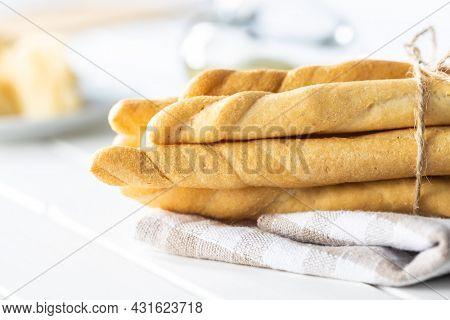 Grissini sticks. Traditional italian bread sticks on white table.