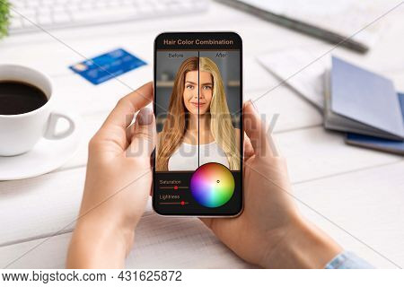 Woman Using Hair Color Simulation App On Mobile Phone