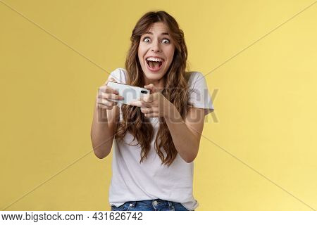 Extremely Happy Thrilled Playful Girl Gamer Playing Awesome Great New Smartphone Game Hold Mobile Ph