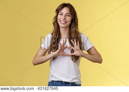 You My Valantine. Tender Confident Adult Girl Curly Hairstyle Show Heart Gesture Near Chest Express