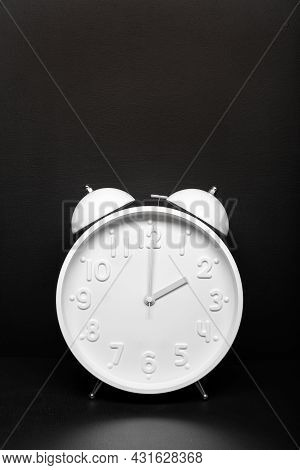 Daylight Saving Time Concept. White Retro Clock Isolated On Black Background. Copy Space
