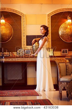 Aristocracy. Sophisticated Rich Lady Standing. Orient Antique Interior