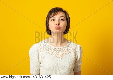 Photo Of Affectionate Adorable Woman Keeps Lips Rounded Wants To Kiss Someone With Love Flirts With