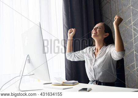 Goal Achievement. Hilarious Overjoyed Young Woman Scream Yes And Raising Hands Up In Victory Gesture