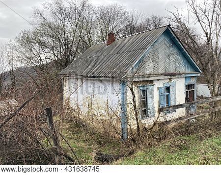 Old Destroyed House In Countryside. Building Exterior Of Abandoned Rustic House In Mountainous Terra