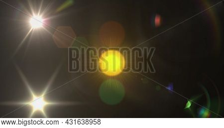 Image of changing traffic lights glowing yellow spot of light lens flare moving in hypnotic motion in seamless loop in the background. Light colour and movement concept digitally generated image.