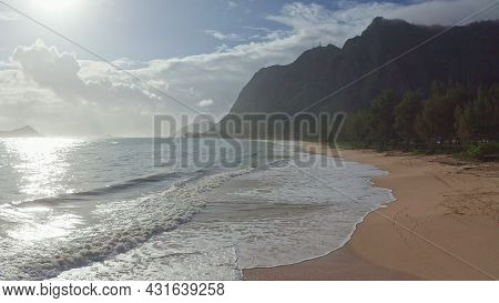 Colorful Aerial View Of Rocky Mountains. A Tropical Beach With Turquoise Blue Ocean Water And Waves