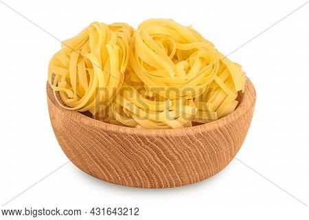 Raw Tagliatelle Pasta In Wooden Bowl Isolated On White Background With Clipping Path And Full Depth
