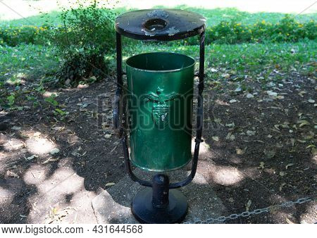 Outdoor Metal Public Trash Can Close Up. Garbage Can In A Public Park In Bucharest, Romania, 2021