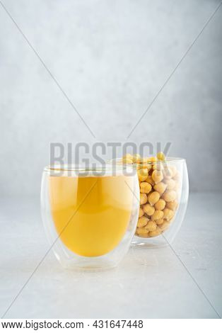 Chickpea Aquafaba. Egg Replacement. Vegan Cooking Concept. Chickpea, Chickpea Water In Glass Cup. On