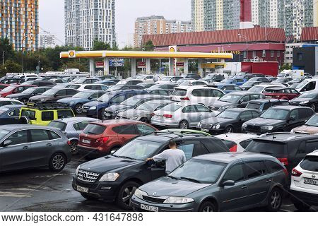 There Are Many Cars In The Parking Lot Next To The Gas Station And The Residential Area. Moscow, Rus