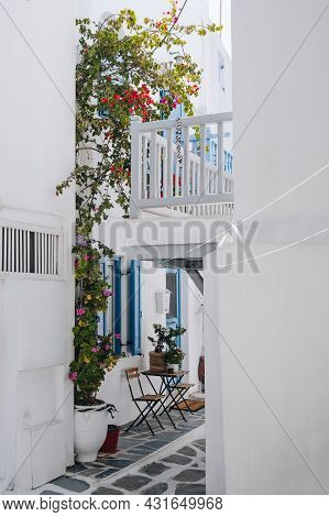 Table And Chairs Outside A Traditional Whitewashed House With Blue Details In Hora (mykonos Town), G
