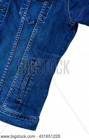 Denim Jacket With Side Pocket. Part Of A Blue Denim Jacket With Pockets And Classic Stitching