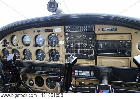 Interior Displays And Controls In The Cockpit Of An Old Plane On The Instrument Panel