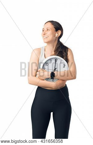 Sportive Young Woman Is Hugging Or Embracing A Wall Clock.