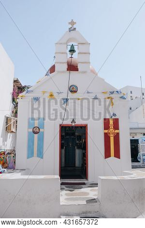 Mykonos Town, Greece - September 24, 2019: Facade Of The Open Church With A Red-painted Dome On A St