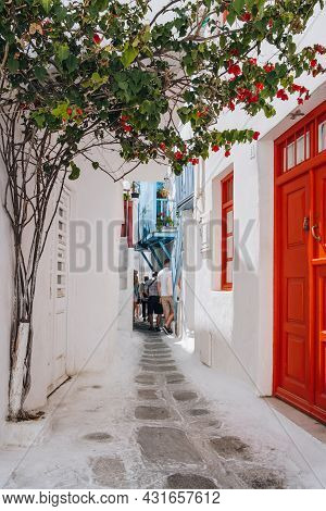 Mykonos Town, Greece - September 23, 2019: Whitewashed Buildings On A Narrow Street In Hora (also Kn