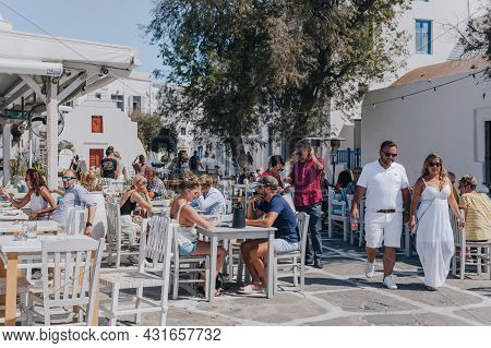 Mykonos Town, Greece - September 23, 2019: People Sitting At The Outdoor Tables Of A Restaurant In L