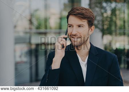 Handsome Unshaven Male Executive Worker Left Business Building Hears Important Information Via Speed