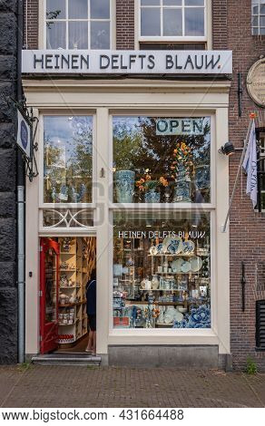 Amsterdam, Netherlands - August 13, 2021: Closeup Of Front Of Heinen Delfts Blauw Gift Shop On Prins
