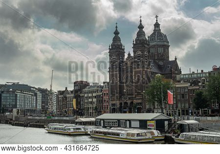 Amsterdam, Netherlands - August 14, 2021: Brown Stone Basilica Of Saint Nicolas With 2 Towers And 1