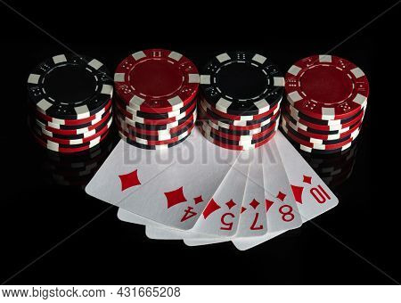 Poker Game With Flush Combination. Chips And Cards On The Black Table. Successful And Win. Free Adve