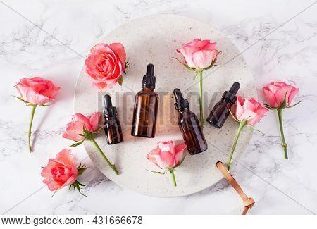 essential oils in bottles rose flowers. alternative medicine spa aromatherapy
