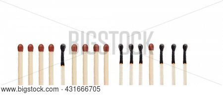 Burnt and unburned matchsticks isolated on a white background