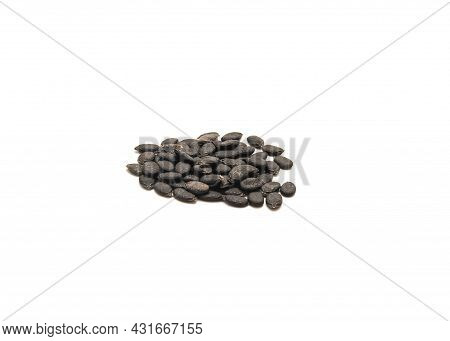 Heap Of Organic Angled Luffa Or Chinese Okra Seeds Isolated On White