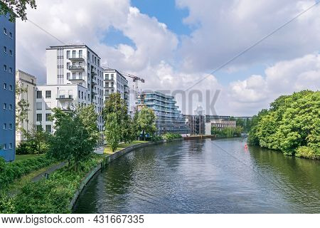 Berlin, Germany - July 3, 2021: Bank Of The River Spree Schleswiger Ufer With Recently Erected Build