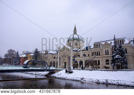 Academy Of Fine Arts Exterior Building In The Winter And Festina Lente Bridge In Sarajevo, Bosnia An