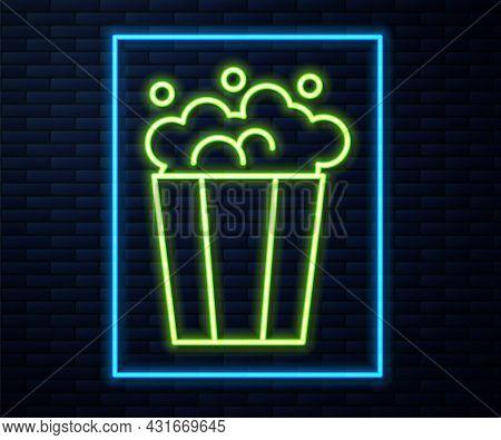 Glowing Neon Line Popcorn In Cardboard Box Icon Isolated On Brick Wall Background. Popcorn Bucket Bo