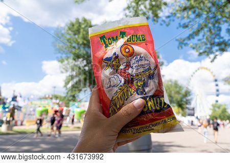 Falcon Heights, Minnesota - August 30, 2021: Hand Holds Up A Tom Thumb Bag Of Mini Donuts At The Min
