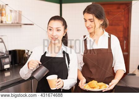 Focusing On Half-body Angle Of Asian Barista Women Stop Filling Milk Into Takeaway Hot Coffee Cup Wh