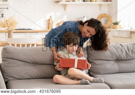 Birthday Of Child In Family: Happy Mother Giving Gift In Decorated Present Box To Excited Kid On Ann