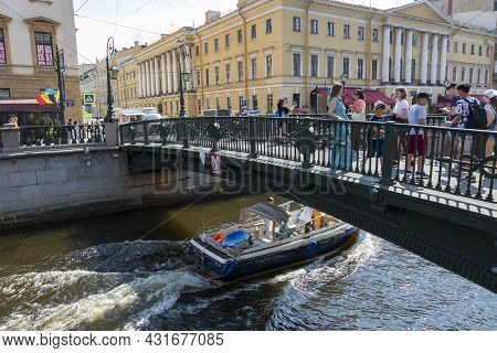 St. Petersburg, Russia - July 09, 2021: People In The Italian Bridge Through The Griboedov Canal In