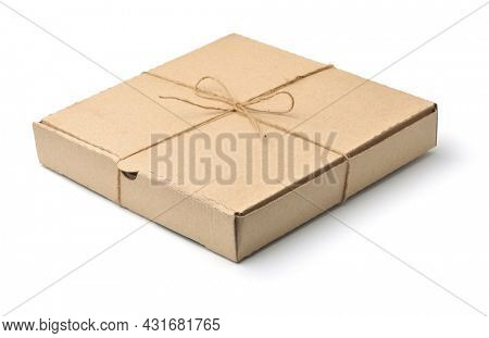 Blank brown cardboard pizza box tied with jute twine isolated on white