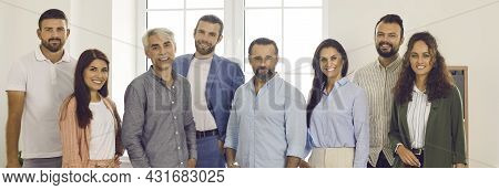 Banner With Group Portrait Of Happy Business People Standing In Office And Smiling