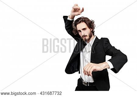 Portrait of a handsome well-groomed man fashion model posing in motion at studio. White background with copy space. Fashion concept.