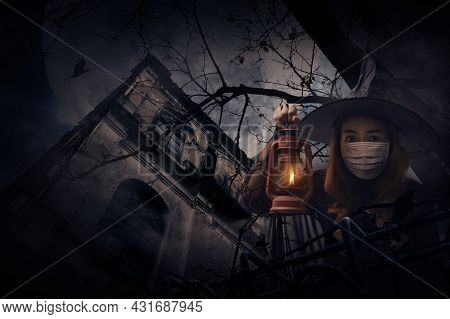 Halloween Witch Wearing Medical Face Mask Holding Ancient Lamp Standing Over Grunge Castle, Dead Tre