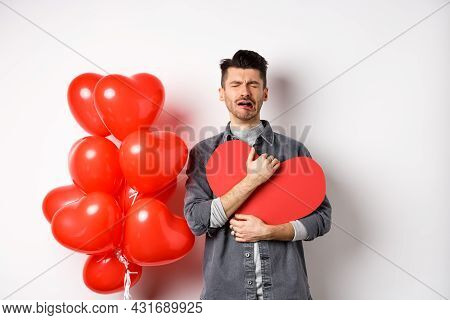 Crying Man Standing Single And Lonely On Valentines Day, Hugging Heart Cutout And Sobbing Miserable,