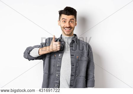 Excited Handsome Guy Showing Thumb Up And Smiling, Like Good Thing, Praise Awesome Choice, Looking S
