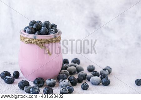 Bowl With Yogurt And Blueberries On Table. Blueberry Yogurt With Fresh Blueberries. Healthy Breakfas