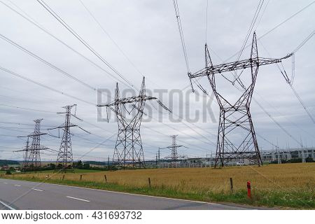 Distribution Electric Substation With Power Lines And Transformers. High Voltage Power Transformer S