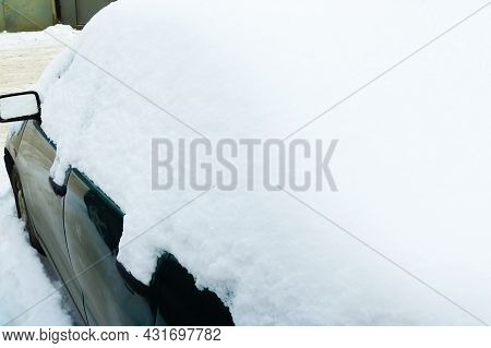 The Car Was Covered With Snow. The Onset Of Winter, Bad Weather