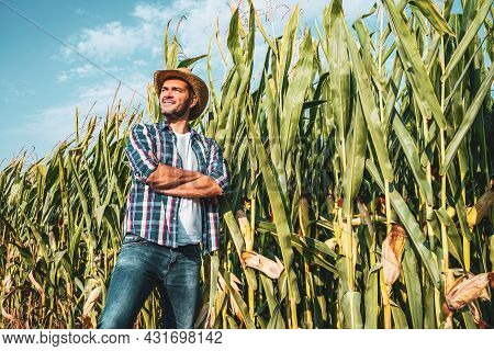Happy Farmer Is Proudly Posing By His Growing Corn Field.