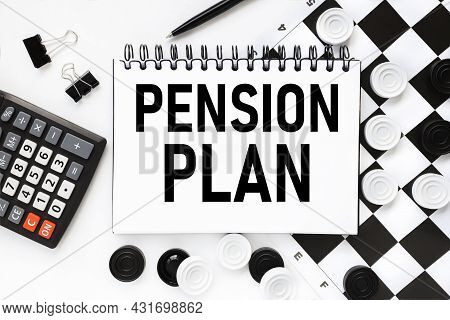 Pension Plan. Notepad On A White Background Near The Chessboard, Checkers Of White And Black Color