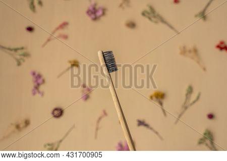 Zero-waste, Biodegradable Bamboo Toothbrush On Beige Background
