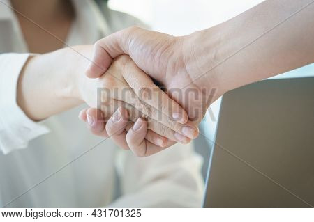 Businesswoman Shaking Hand For A Complete Business Deal Together Successful, Finishing Up A Meeting.